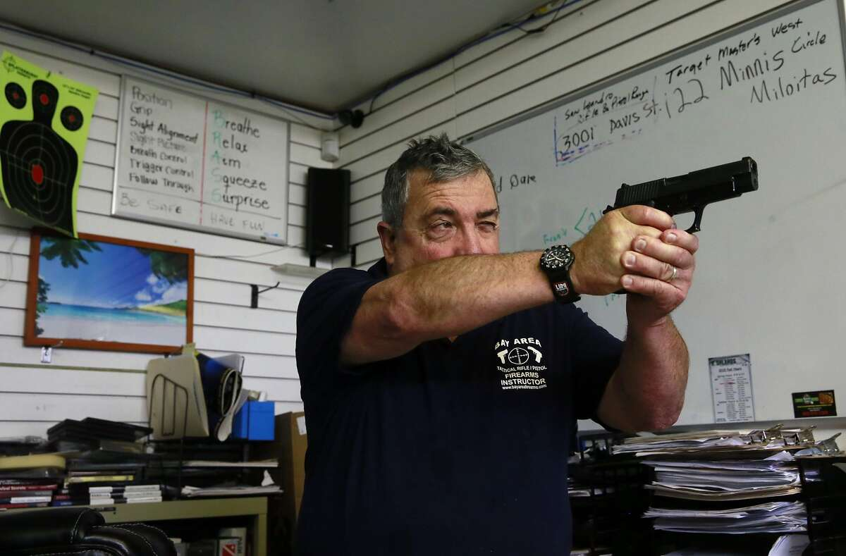 Scott Jackson owner of Bay Area Firearms Instruction holds a course in C.C.W., (concealed carry weapon) at his office in Burlingame, Calif., on Thurs. September 22, 2016.