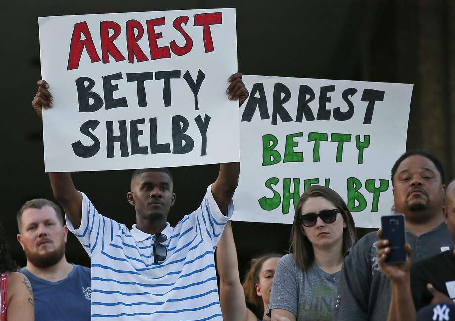 Demonstrators hold signs at a recent protest over the police shooting death of Terence Crutcher, in Tulsa, Okla. An officer faces first-degree manslaughter charges. Photo: Sue Ogrocki, Associated Press