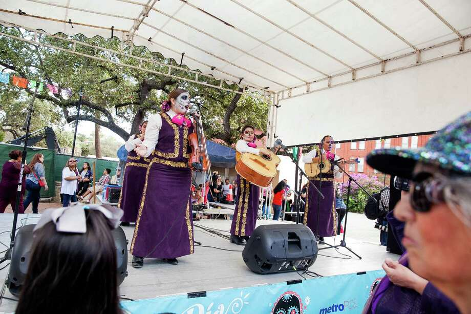 Mariachi performance during Dia de Los Muertos festival in 2015 were held at La Villita. The free event offered many food and art vendors, La Monas dance, drum and puppet procession, living altar offerings, bands, mariachis and spoken-word poetry. Photo: Express-News File Photo