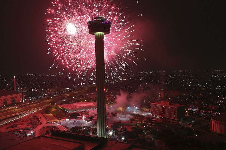 Fireworks explode over Hemisfair Park and the Tower of the Americas in this view from the Alteza Residences at the start of Celebrate San Antonio fireworks display in 2015. A crowd of between 150,000 to 200,000 is expected for this year's event. Photo: Jerry Lara /San Antonio Express-News / © 2014 San Antonio Express-News