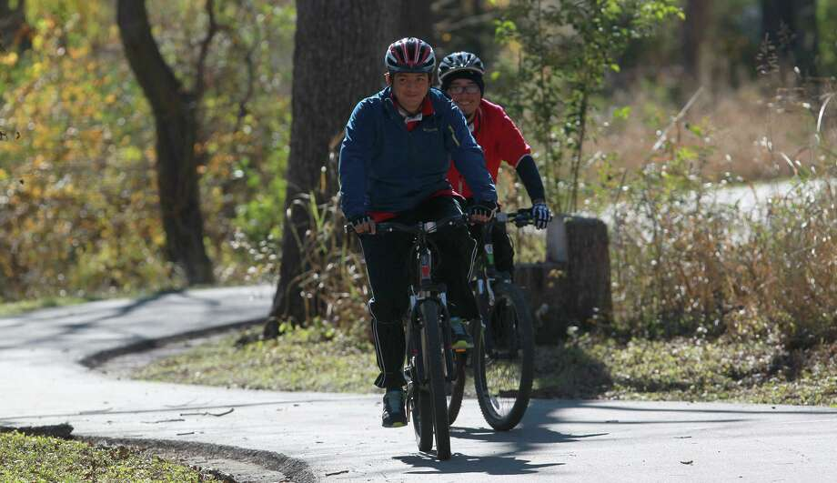 Cyclists ride the trail on the Salado Creek Greenway, part of the Howard W. Peak Greenway Trails System — one of the many things for which we, as a community, should be thankful, according to a reader. Photo: File Photo /San Antonio Express-News / ©San Antonio Express-News/Photo may be sold to the public