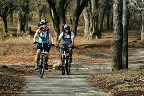 A couple rides the trails at McAllister Park in 2008.