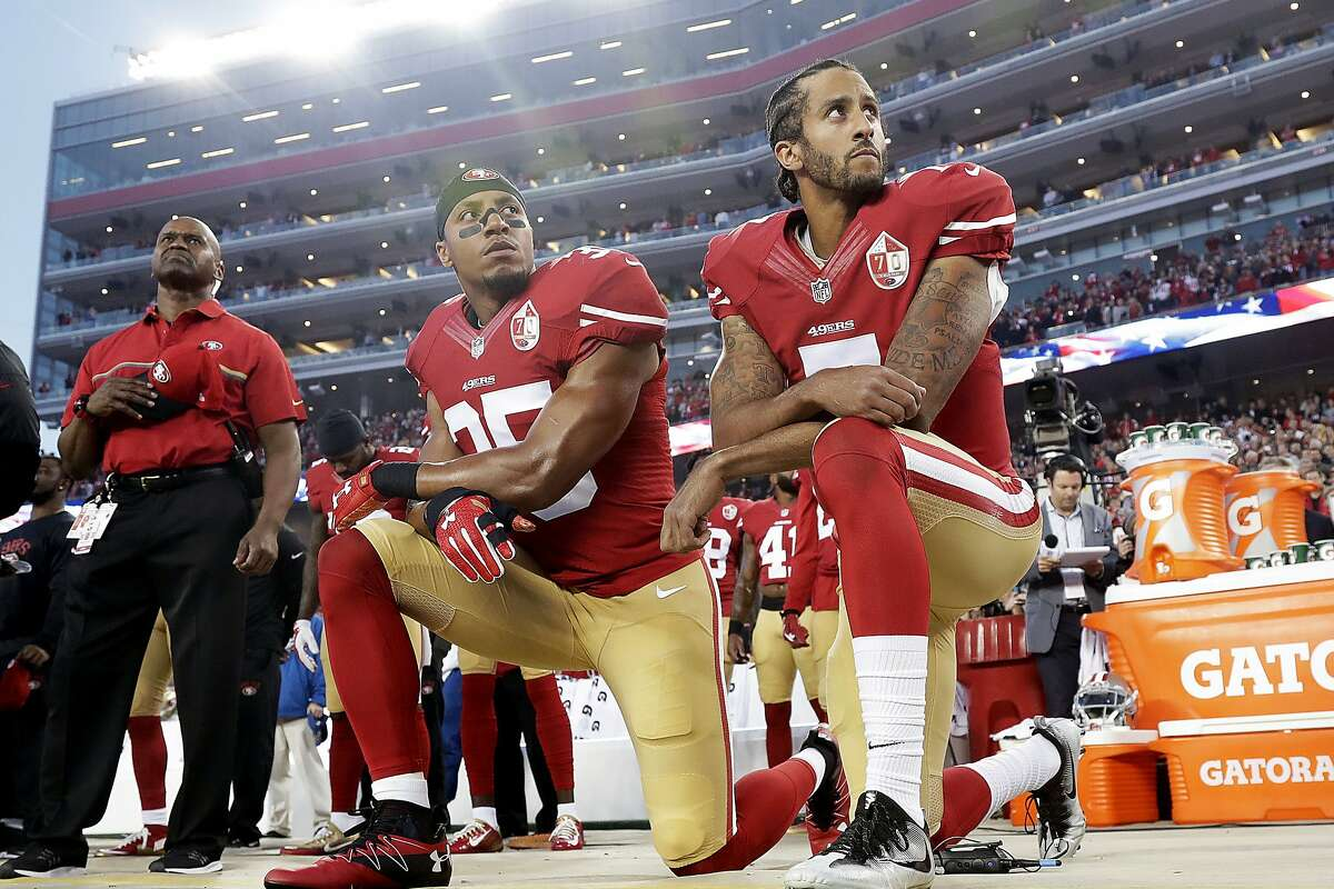 Then-49ers teammates Colin Kaepernick (right) and Eric Reid kneel during the national anthem before a September 2016 game against the Rams at Levi's Stadium.