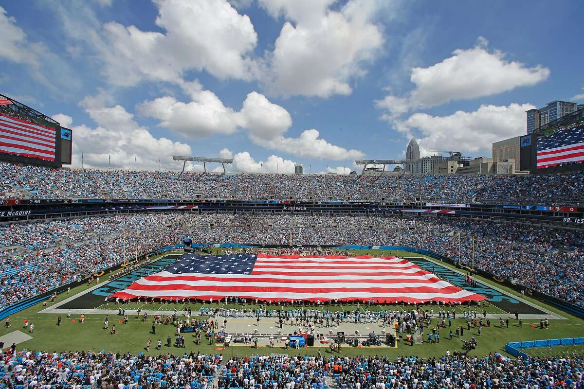 Fans and players stand during the national anthem before an NFL football game between the Carolina Panthers and the San Francisco 49ers in Charlotte, N.C., Sunday, Sept. 18, 2016. (AP Photo/Bob Leverone)