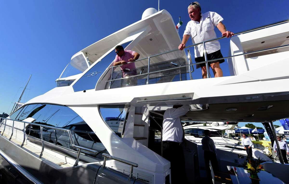 Scott Caroll and Andre Kelly of Greenwich check out a Azimut Flybridge 66 during the Norwalk Annual Boat Show at Cove Marina in Norwalk, Conn. Thursday, September, 22, 2016. The Show runs through Sunday from 10am to 7pm.
