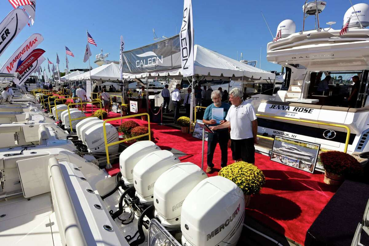 William Tryon and Richard Silva look at a Boston Whaler during the Norwalk Annual Boat Show at Cove Marina in Norwalk, Conn. Thursday, September, 22, 2016. The Show runs through Sunday from 10am to 7pm.