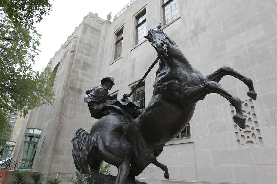 "The sculpture ""Checkmate"" by sculptor Herb Mignery sits outside the Briscoe Western Art Museum on the corner of Presa and Markets streets at the Briscoe Western Art Museum. Photo: Kin Man Hui /San Antonio Express-News / ©2013 San Antonio Express-News"
