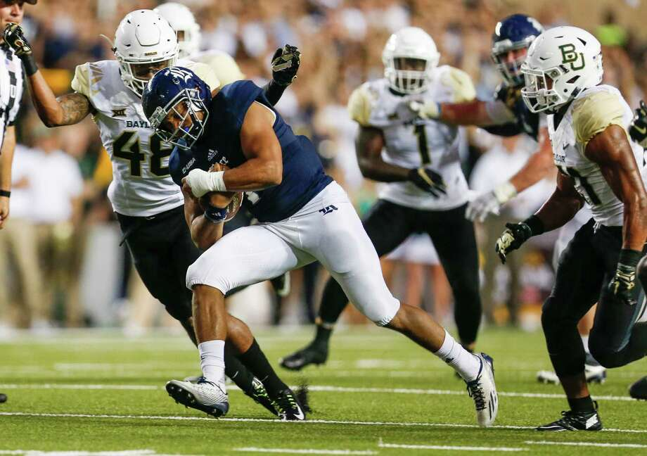 Rice running back Darik Dillard (1) is caught by Baylor defensive back Travon Blanchard (48) during the first quarter of an NCAA football game at Rice Stadium on Friday, Sept. 16, 2016, in Houston. ( Brett Coomer / Houston Chronicle ) Photo: Brett Coomer, Staff / © 2016 Houston Chronicle