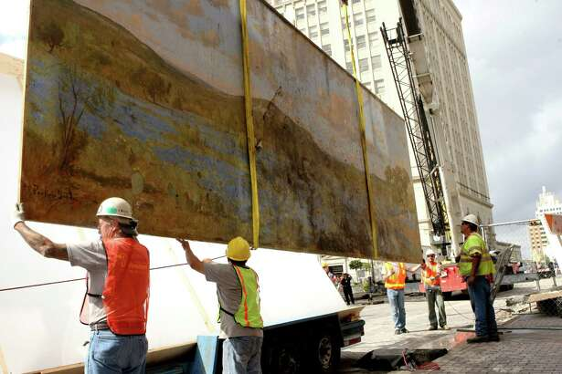 Workers placed the painting in a travel frame for transportation to the Witte, where the history and science museum kept it in storage among its collections.