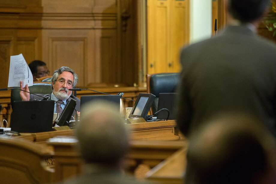S.F. Supervisor Aaron Peskin questions Department of Building Inspection officials about the Millennium Tower. Inspectors knew in 2009 that the building was sinking more than expected. Photo: Santiago Mejia, Special To The Chronicle