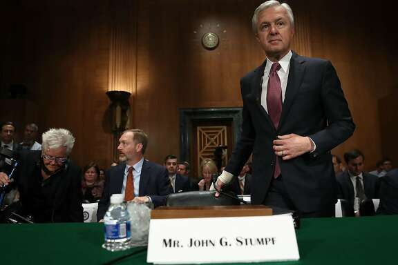"""WASHINGTON, DC - SEPTEMBER 20:  John Stumpf, chairman and CEO of the Wells Fargo & Company, arrives for testimony before the Senate Banking, Housing and Urban Affairs Committee September 20, 2016 in Washington, DC. The committee heard testimony on the topic of """"An Examination of Wells Fargo's Unauthorized Accounts and the Regulatory Response.""""  (Photo by Win McNamee/Getty Images)"""