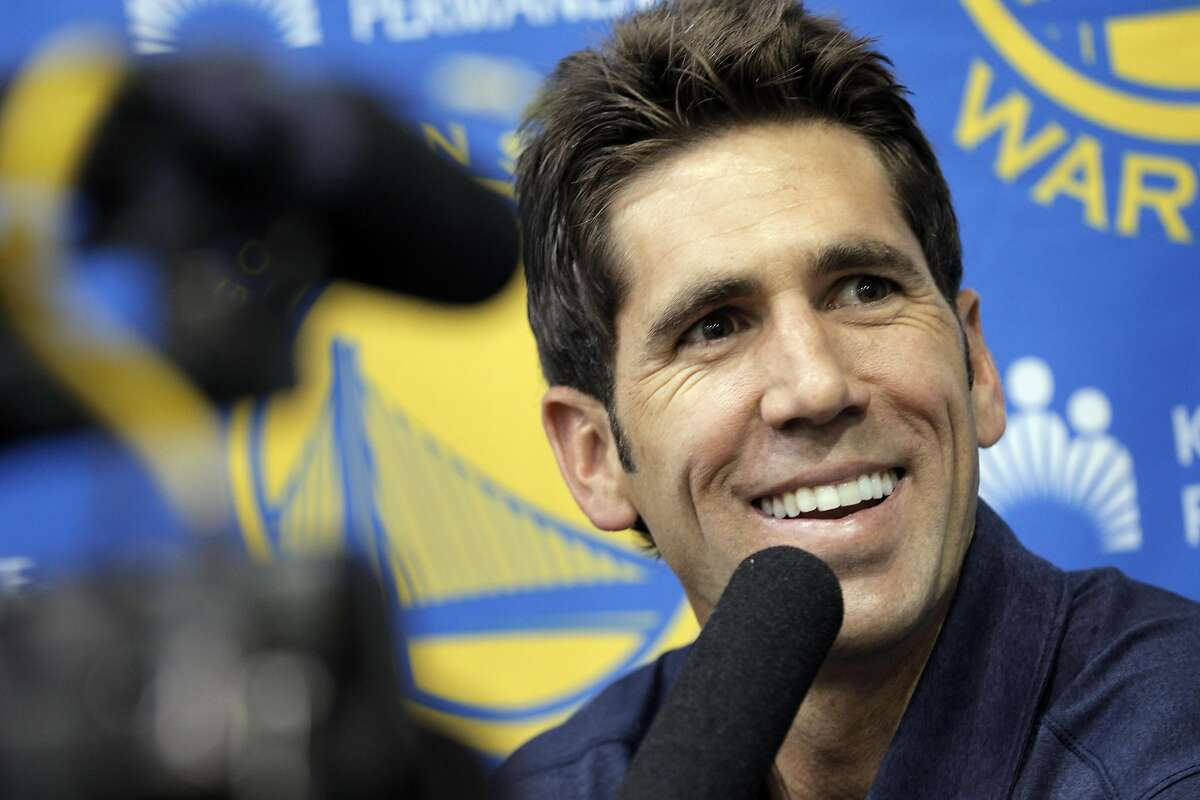 Warriors General Manager Bob Myers, listens to a reporter's question as he speaks with the press at the team's practice facility in Oakland, Calif., on Thursday, September 22, 2016. Myers addressed several topics including athlete protests and how the NBA might deal with them, and general team news.