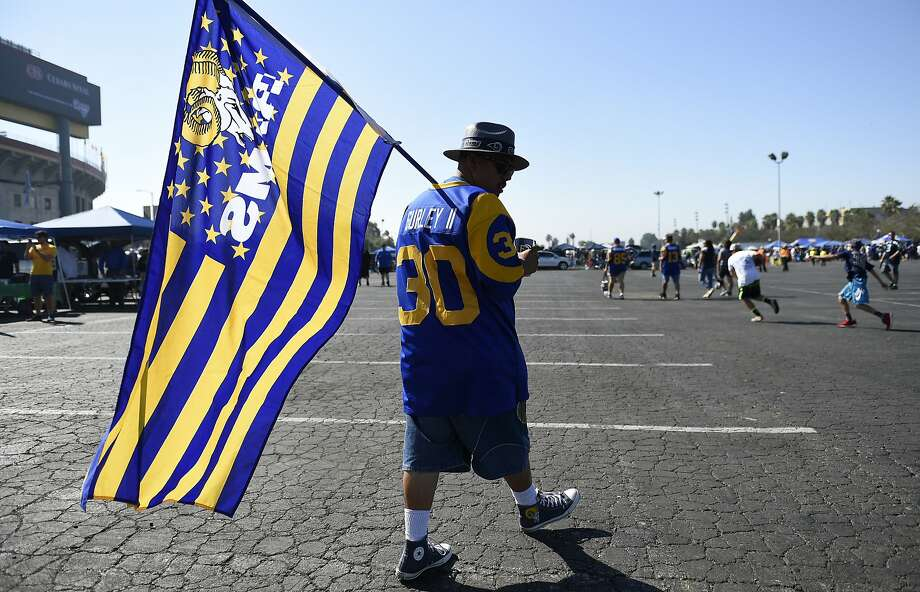 A fan walks the parking lot prior to an NFL football game between the Los Angeles Rams and the Seattle Seahawks at Los Angeles Memorial Coliseum, Sunday, Sept. 18, 2016, in Los Angeles. (AP Photo/Kelvin Kuo) Photo: Kelvin Kuo, Associated Press