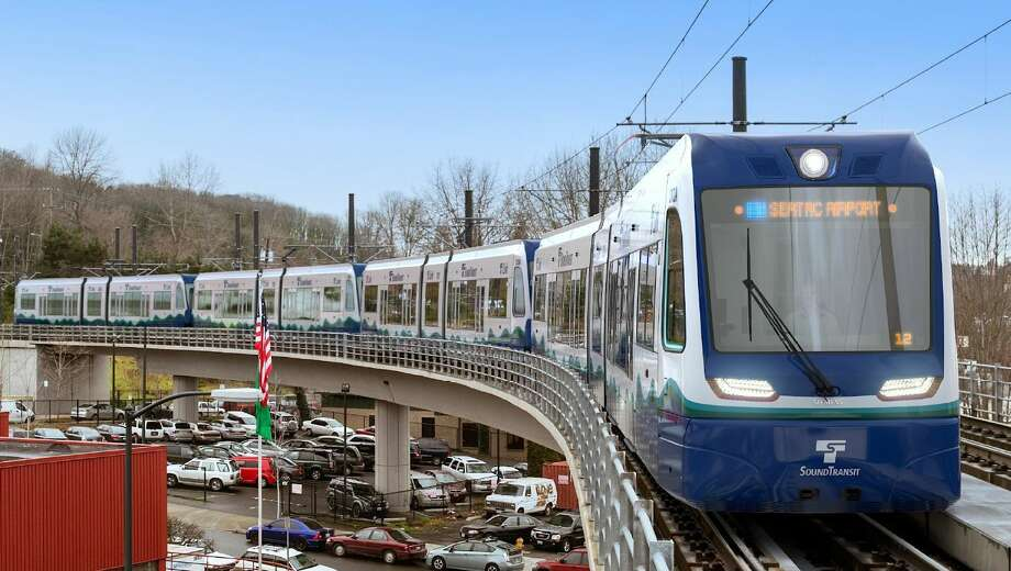 Renderings show roughly what Sound Transit's 122 new light rail cars will look like when they start arriving for testing in 2019. The transit agency announced the $554 million order. New cars will have more space for luggage, bikes and people as light rail expands north, south and east as Sound Transit 2 is built out. Photo: Courtesy Sound Transit