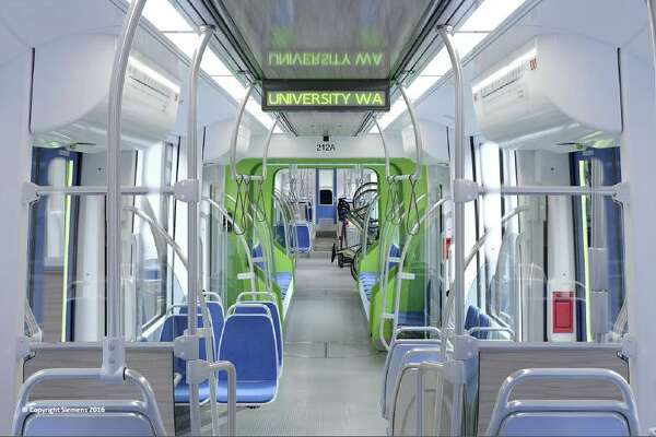 Renderings show roughly what Sound Transit's 122 new light rail cars will look like when they start arriving for testing in 2019. The transit agency announced the $554 million order Thursday. New cars will have more space for luggage, bikes and people as light rail expands north, south and east as Sound Transit 2 is built out.