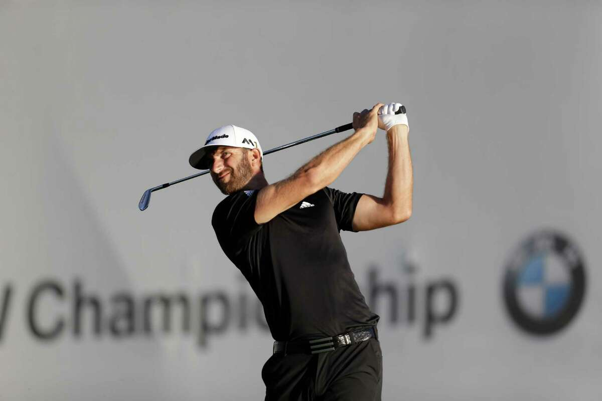 Dustin Johnson watches his shot off the tee on he 17th hole during the third round of the BMW Championship golf tournament at Crooked Stick Golf Club in Carmel, Ind., Saturday, Sept. 10, 2016. (AP Photo/AJ Mast)