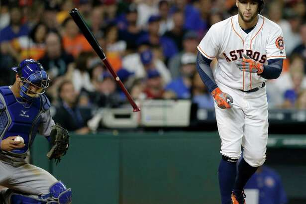 Houston Astros  George Springer takes the base on a walk against the Chicago Cubs during the seventh inning at Minute Maid Park Saturday, Sept. 10, 2016, in Houston.  ( Melissa Phillip / Houston Chronicle )
