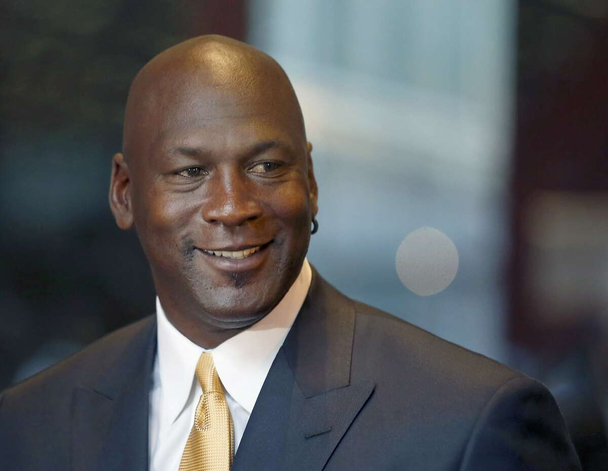 FILE - In this Aug. 21, 2015, file photo, former NBA star and current owner of the Charlotte Hornets, Michael Jordan, smiles at reporters in Chicago. Jordan has made another major donation, pledging $5 million to the Smithsonian's new African-American history museum on the National Mall, officials at the National Museum of African American History and Culture announced Monday, Aug. 8, 2016. (AP Photo/Charles Rex Arbogast, File)
