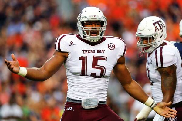 Texas A&M defensive lineman Myles Garrett  celebrates after sacking Auburn's Sean White.