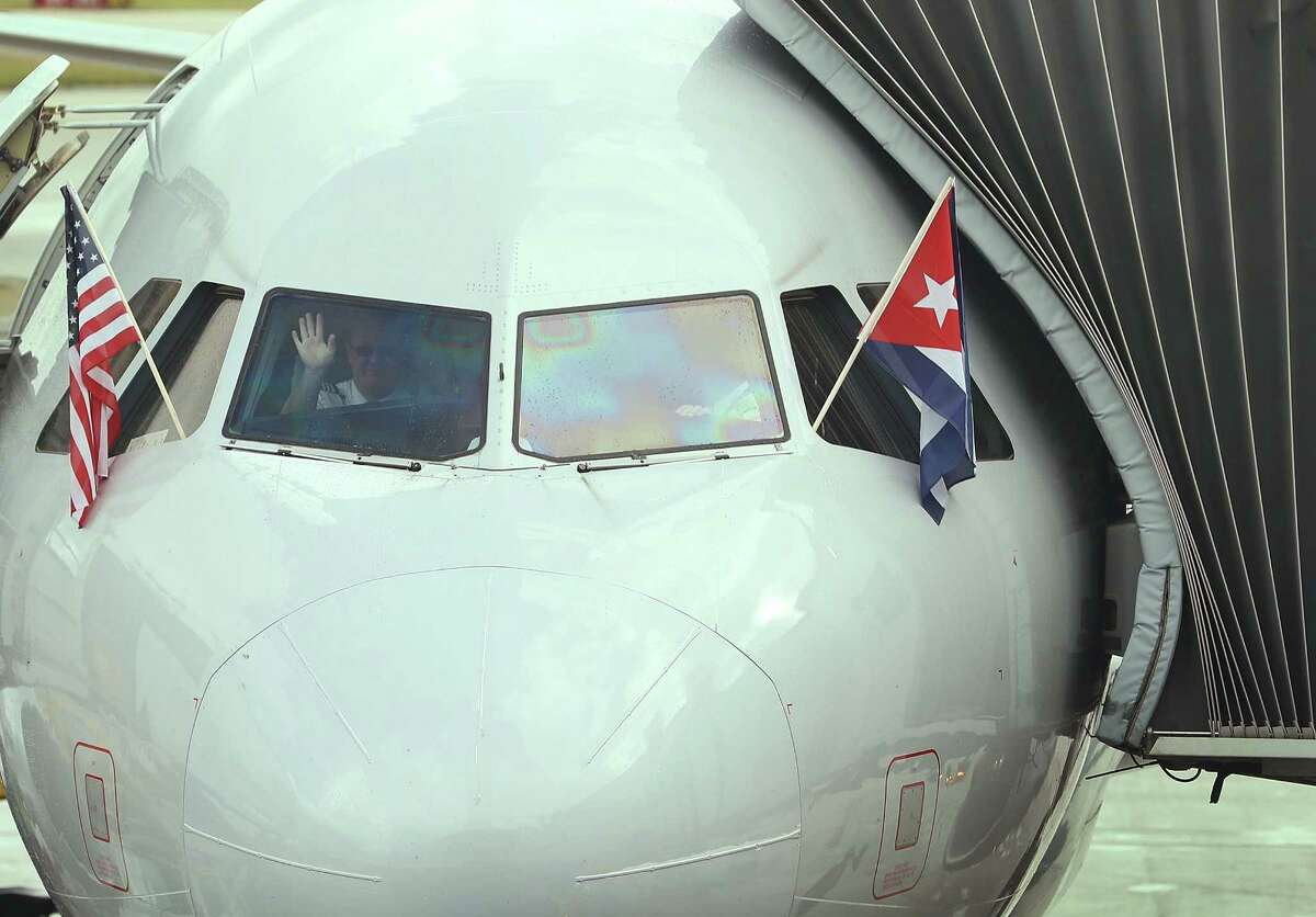 MIAMI, FL - SEPTEMBER 07: A pilot waves as he prepares to push back from the gate in American Airlines Flight 903, becoming the first commercial flight from Miami to Cuba in 55-years on September 7, 2016 in Miami, Florida. The flights that left today went to Cienfuegos and Holgun and American Airlines said they will be adding scheduled service from Miami to Camaguey, Cuba and Santa Clara, Cuba on Sept. 9 and from Miami to Varadero, Cuba on Sept. 11 with the airline hoping to begin service to Havana later this year. (Photo by Joe Raedle/Getty Images) *** BESTPIX ***