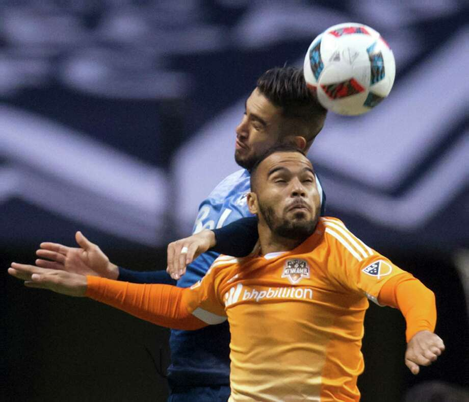 Houston Dynamo's Alex Monteiro de Lima, front, and Vancouver Whitecaps' Pedro Morales vie for the ball during the first half of an MLS soccer game in Vancouver, British Columbia, on Saturday, March 26, 2016. (Darryl Dyck/The Canadian Press via AP) Photo: DARRYL DYCK, SUB / The Canadian Press