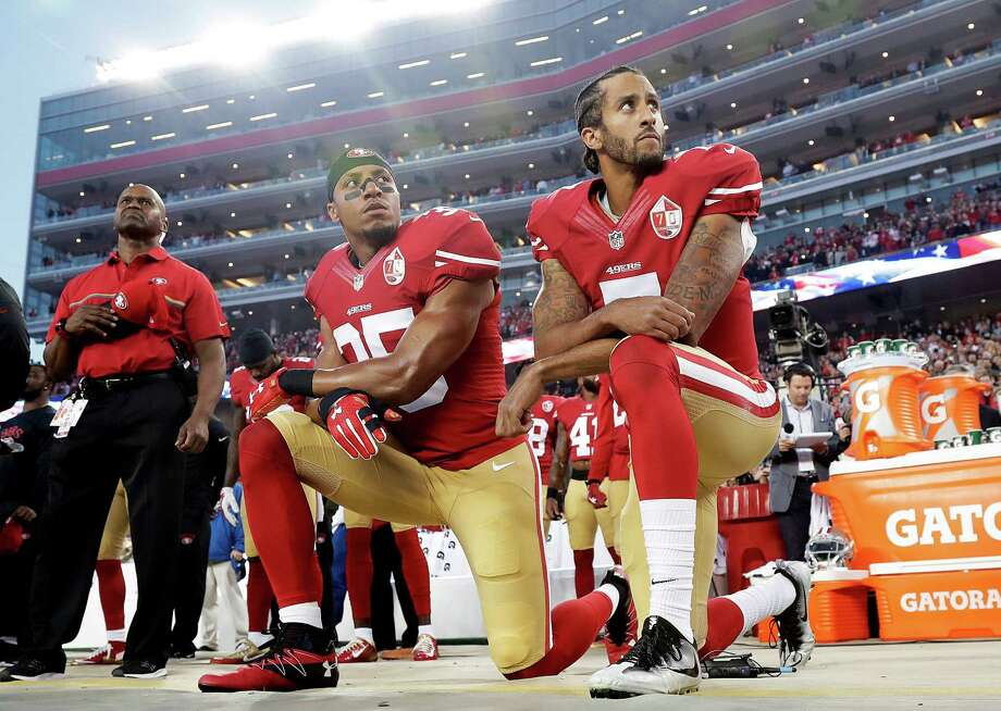 San Francisco 49ers safety Eric Reid (35) and quarterback Colin Kaepernick (7) kneel during the national anthem before an NFL game against the Los Angeles Rams. A reader says people should not be so quick to condemn the protesters. Photo: Marcio Jose Sanchez /Associated Press / Copyright 2016 The Associated Press. All rights reserved.