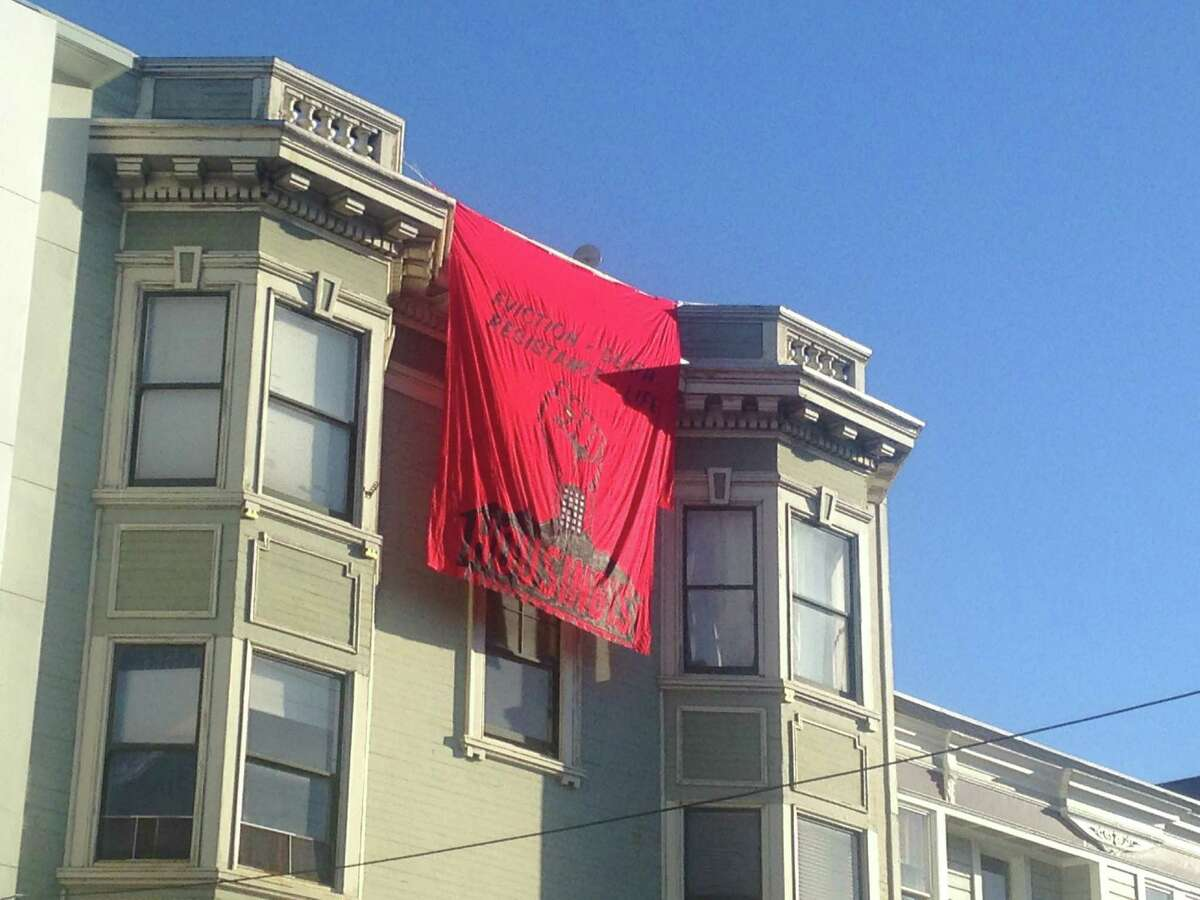 """The banner hung by protestors at 100-year-old Iris Canada building on Thursday reads, """"Eviction = Death. Resistance = Life."""" The protest was part of a national call to protest evictions, housing and gentrification. Mecca, the director of counseling programs at Housing Rights Committee"""
