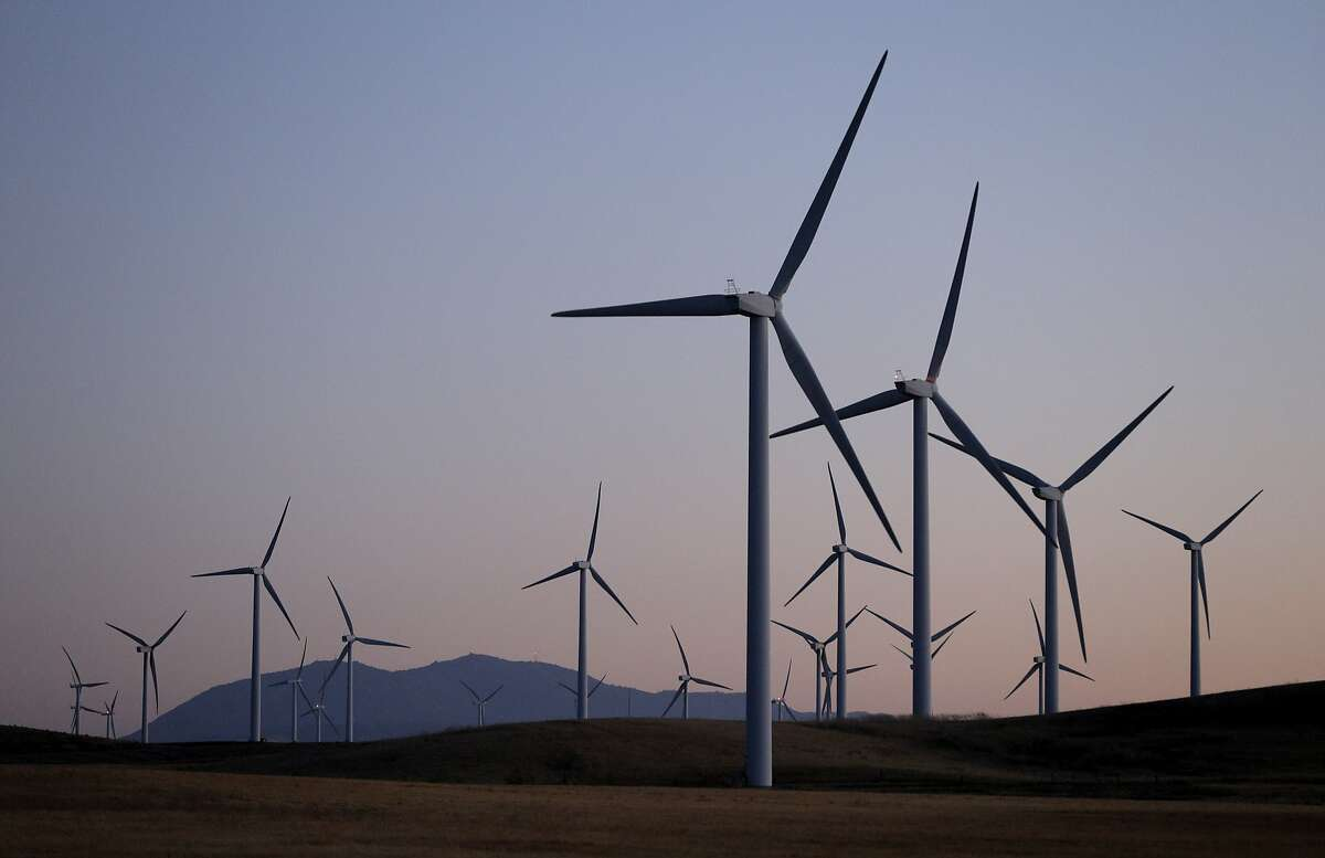 Wind tubines of the Shiloh Wind Power Plant, with Mt. Diablo in the background in the delta area outside Rio Vista, Calif., on Wednesday, September 21, 2016. The region has hundreds of wind turbines that generate power for the state.