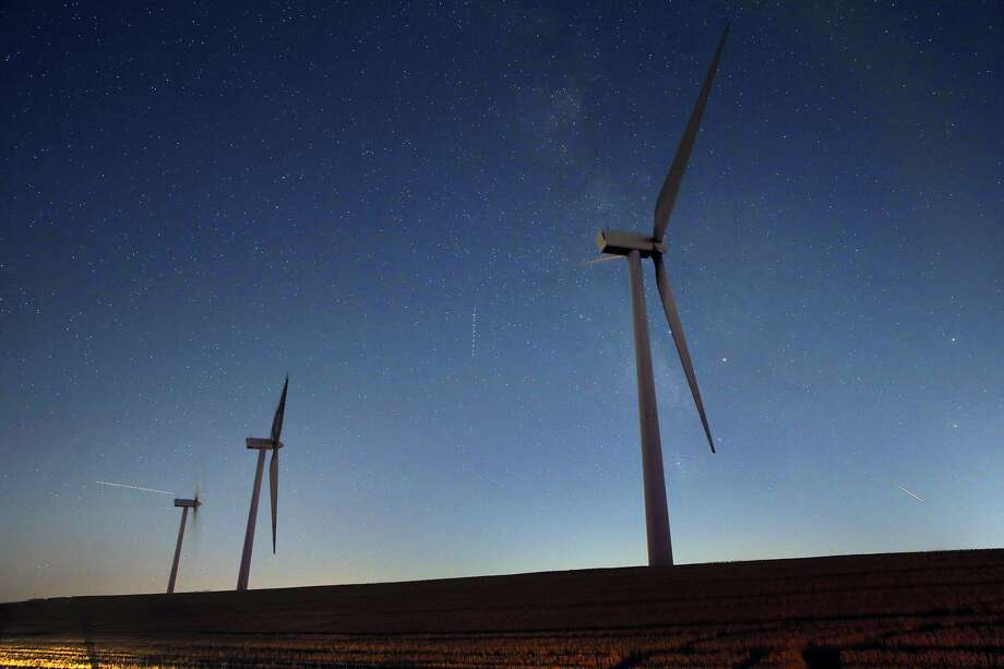 Wind turbines, such as these from the Shiloh Wind Plant near Rio Vista, are helping California meet its renewable energy goals early.  State law requires that the utilities achieve 50 percent renewable power by 2030. Photo: Carlos Avila Gonzalez, The Chronicle