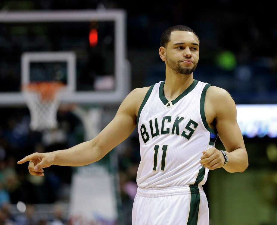 Point guard Tyler Ennis is bringing his high basketball IQ to the Rockets after Thursday's trade. Ennis averaged 4.5 points and 2.13 assists for the Bucks. Photo: Aaron Gash, FRE / FR171181 AP
