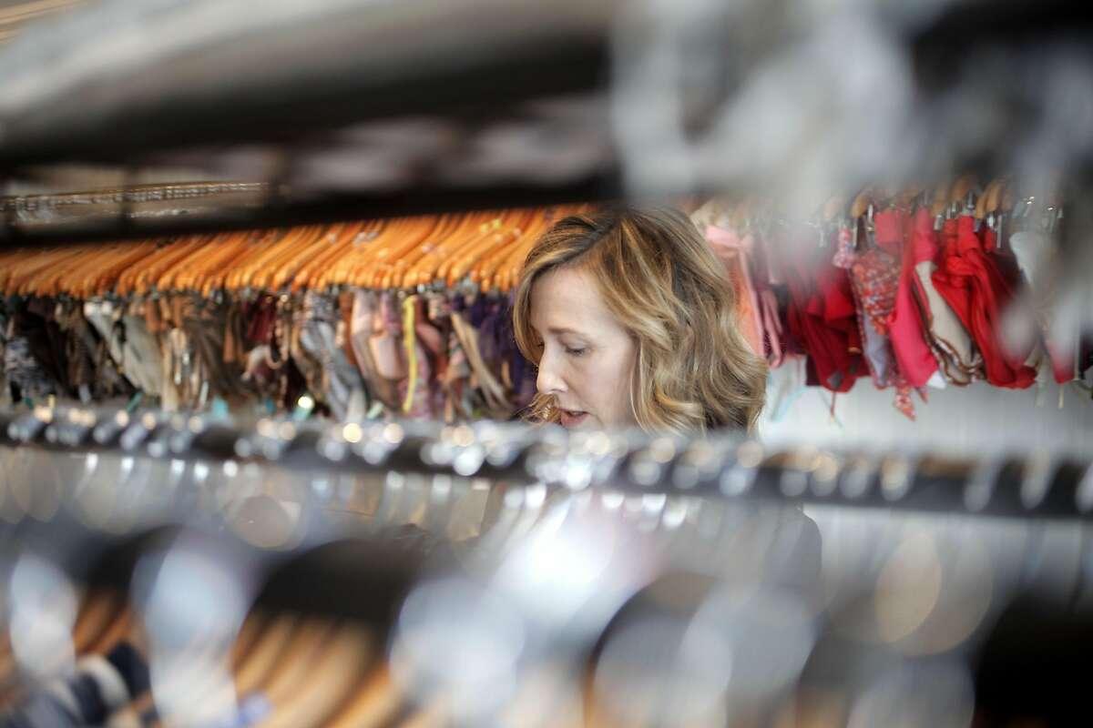 Deidra Carson takes inventory before customers arrive at Beach Bella in San Anselmo, California on Friday, September 9, 2016.