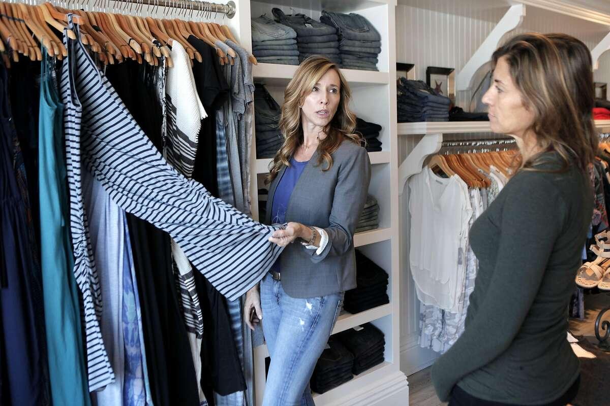 Deidra Carson, left, takes inventory with Beach Bella stylist Kylee Kuhn, right, at Beach Bella in San Anselmo, California on Friday, September 9, 2016.