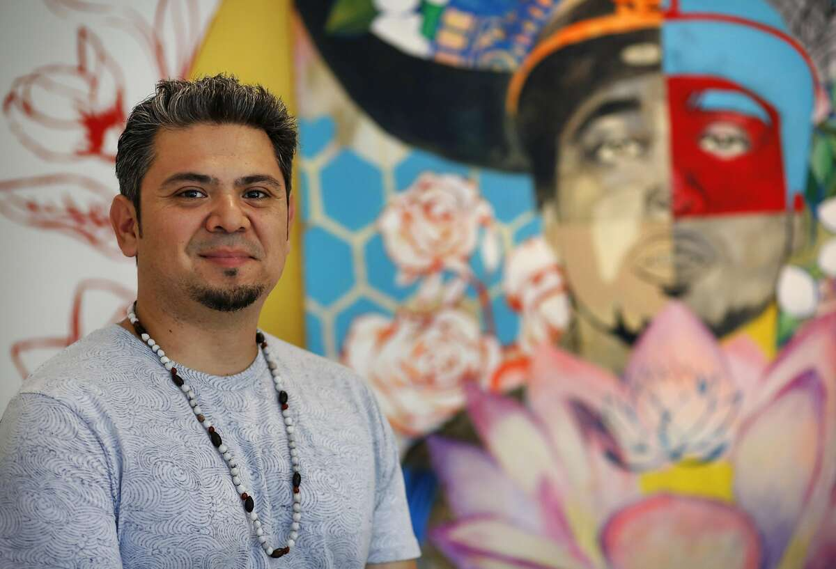 """Artist Josu� Rojas pictured at the Juan R. Fuentes Gallery where he currently has a show titled iG�ntromancer! in the Mission Sept. 22, 2016 in San Francisco, Calif. The work, which was inspired by poems from the community is """"conversations with the spirit of gentrification"""" according to Rojas."""