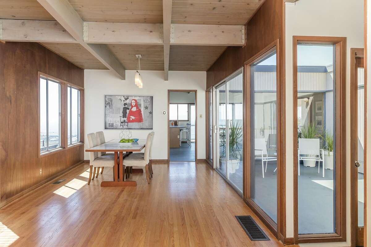 The wood paneled dining room offers views of both the bay and courtyard.