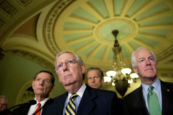FILE - In tis June 21,2016 file photo, Senate Majority Leader Mitch McConnell of Ky., accompanied by, from left, Sen. John Barrasso, R-Wyo., Sen. John Thune, R-S.D., and Senate Majority Whip John Cornyn of Texas, listen to a question during a news conference on Capitol Hill in Washington. Democrats are criticizing the latest Republican version of legislation that's needed to avoid a government shutdown next weekend. Sen. Harry Reid of Nevada told reporters that McConnell will unveil the stopgap spending bill and a long-delayed bill to combat the Zika virus on Thursday, Sept, 22, 2016, but that Democrats haven't signed on to the measure. House Minority Leader Nancy Pelosi said Democrats in that chamber won't back the measure, either.  (AP Photo/Alex Brandon, File)