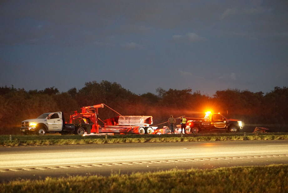 A man died after becoming pinned between a trailer and a vehicle that had rear-ended him as he inspected his trailer on the northbound shoulder in the 6000 block of Southeast Loop 410, Sept. 22, 2016. Photo: Jacob Beltran