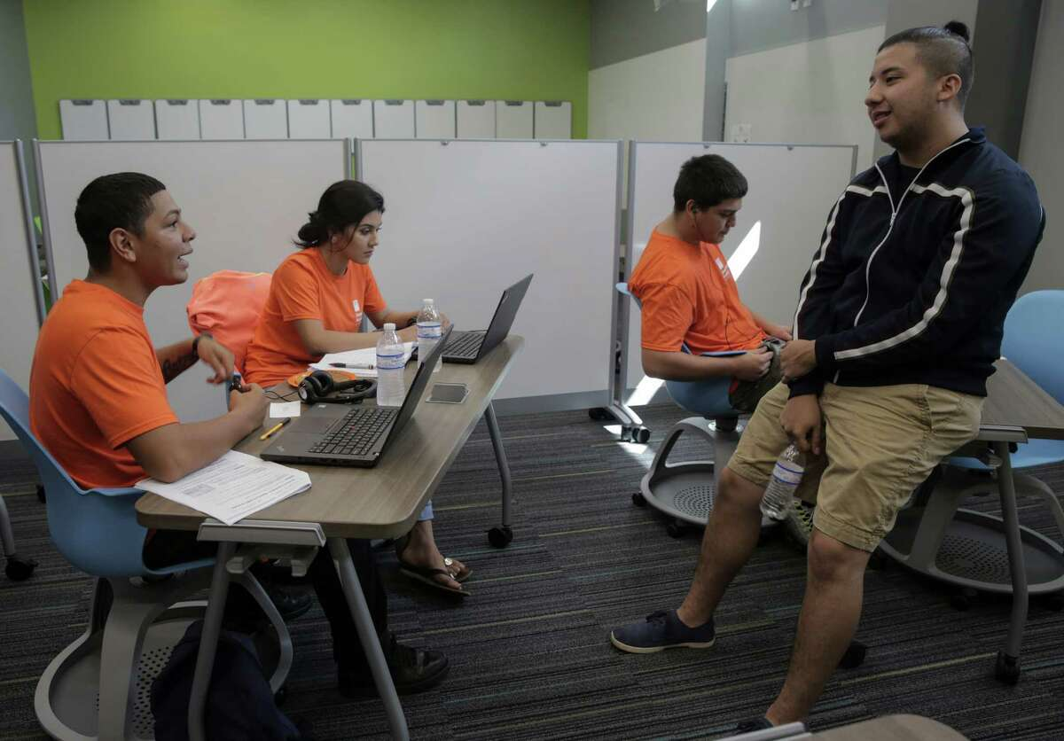 Simon Youth Academy students Manel Jicalan, 18, from left, his sister Andrea Jicalan, 17, Damien Rodriguez, 18, and David Alvarado, 19, chat while working on school work at the school located in the Katy Mills Mall on Thursday, Sept. 22, 2016, in Katy. The academy works on getting non-traditional students their diplomas.