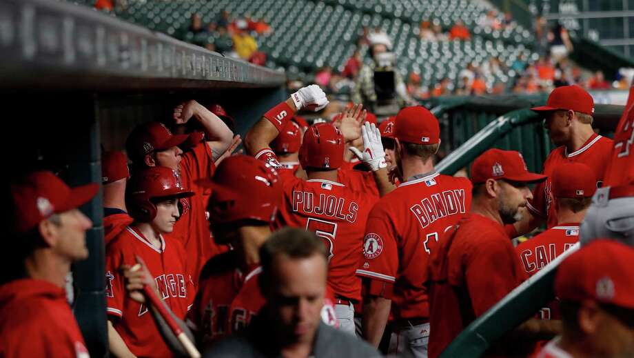 Sept. 22: Angels 2, Astros 0Los Angeles Angels designated hitter Albert Pujols (5) celebrates his two run home run in the visitors dugout with teammates during the first inning of an MLB game at Minute Maid Park, Thursday, Sept. 22, 2016 in Houston. Photo: Karen Warren, Houston Chronicle / 2016 Houston Chronicle