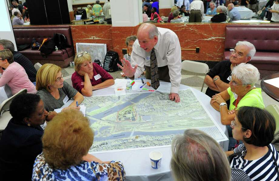 Bill Purcell, Executive Director of the Greater Valley Chamber of Commerce, guides Derby residents in working together to find strong and weak places on the map, as part of the first Downtown Now! workshop in Derby, Conn., on Thursday Sept. 22, 2016. The workshop give Derby resident a say on what a future downtown Derby might look like in the future. Photo: Christian Abraham / Hearst Connecticut Media / Connecticut Post