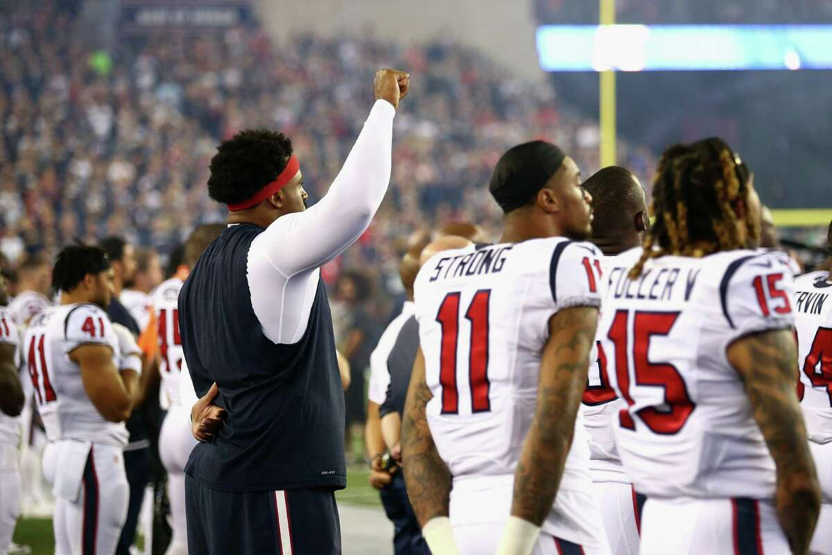 FOXBORO, MA - SEPTEMBER 22: Duane Brown #76 of the Houston Texans raises his fist during the national anthem before the game against the New England Patriots at Gillette Stadium on September 22, 2016 in Foxboro, Massachusetts.