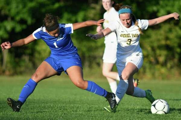 Saratoga's YaYa Van Ness, left, and Averill Park's Bryanna Swinson battle for the ball during their soccer game on Thursday, Sept. 22, 2016, at Averill Park High in Averill Park, N.Y. (Cindy Schultz / Times Union)