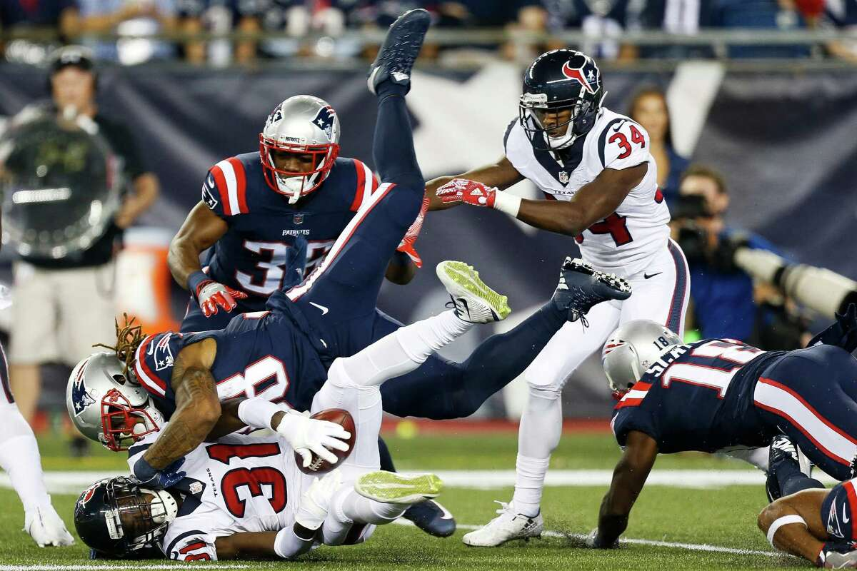 New England Patriots running back Brandon Bolden (38) causes Houston Texans defensive back Charles James (31) to fumble the ball on a kickoff return during the first quarter of an NFL football game at Gillette Stadium on Thursday, Sept. 22, 2016, in Foxborough, Mass. The ball was recovered by the New England Patriots.