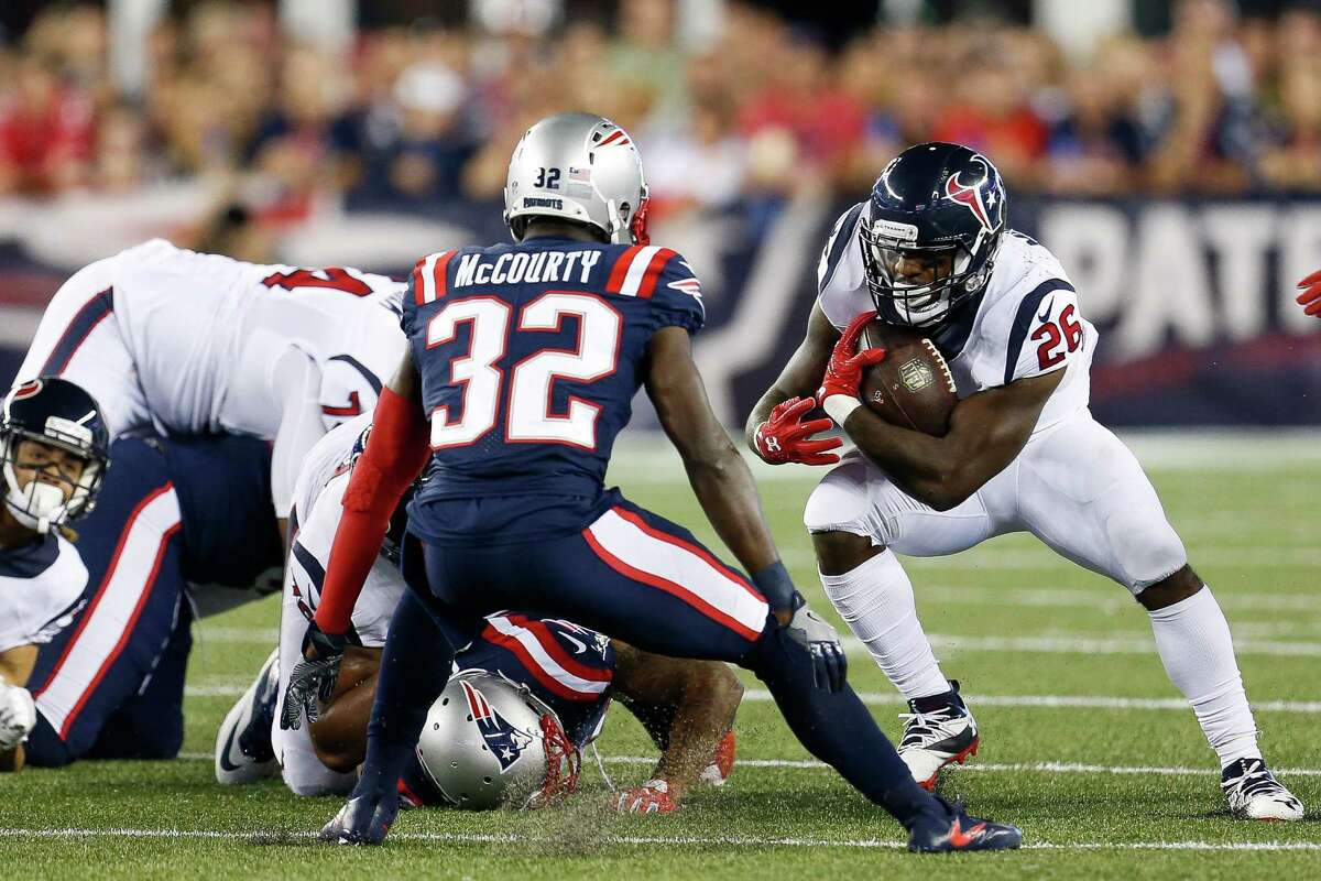 Houston Texans running back Lamar Miller (26) attempts to find a hole during the first quarter of an NFL football game at Gillette Stadium on Thursday, Sept. 22, 2016, in Foxborough, Mass.
