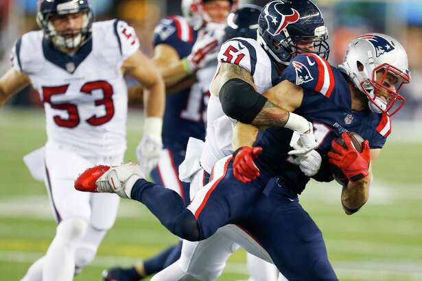 Houston Texans outside linebacker John Simon (51) pushes New England Patriots wide receiver Julian Edelman (11) out of bounds during the first quarter of an NFL football game at Gillette Stadium on Thursday, Sept. 22, 2016, in Foxborough, Mass.