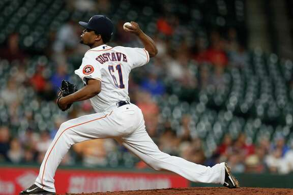 Houston Astros relief pitcher Jandel Gustave (61) pitches during the seventh inning of an MLB game at Minute Maid Park, Thursday, Sept. 22, 2016 in Houston.