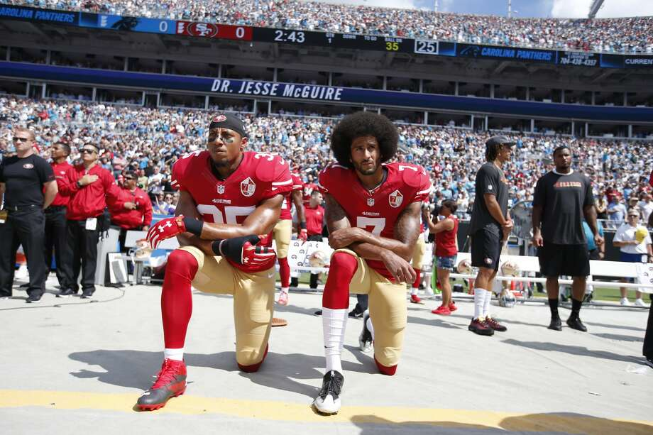 CHARLOTTE, NC - SEPTEMBER 18: Eric Reid #35 and Colin Kaepernick #7 of the San Francisco 49ers kneel on the sideline, during the anthem, prior to the game against the Carolina Panthers at Bank of America Stadium on September 18, 2016 in Charlotte, North Carolina. The Panthers defeated the 49ers 46-27. (Photo by Michael Zagaris/San Francisco 49ers/Getty Images) Photo: Michael Zagaris/Getty Images