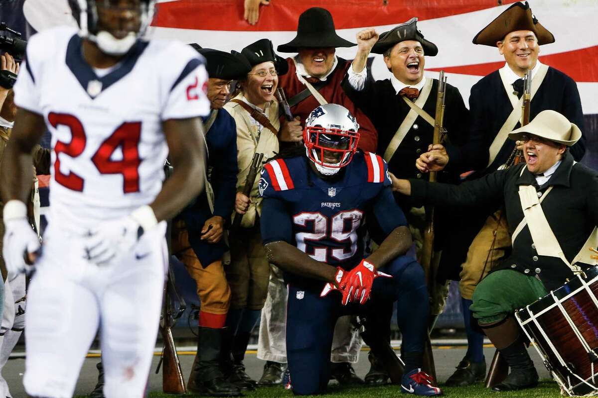 While Patriots running back LeGarrette Blount (29) celebrated with the Minutemen after his second touchdown, Johnathan Joseph and the Texans were left embarrassed in a 27-0 rout at Gillette Stadium. Click through the gallery for John McClain's report card from the game.