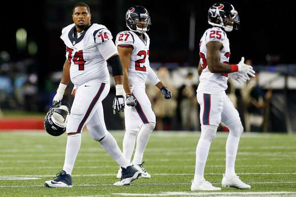 Houston Texans tackle Chris Clark (74) looks up at the scoreboard during the fourth quarter of an NFL football game at Gillette Stadium on Thursday, Sept. 22, 2016, in Foxborough, Mass.