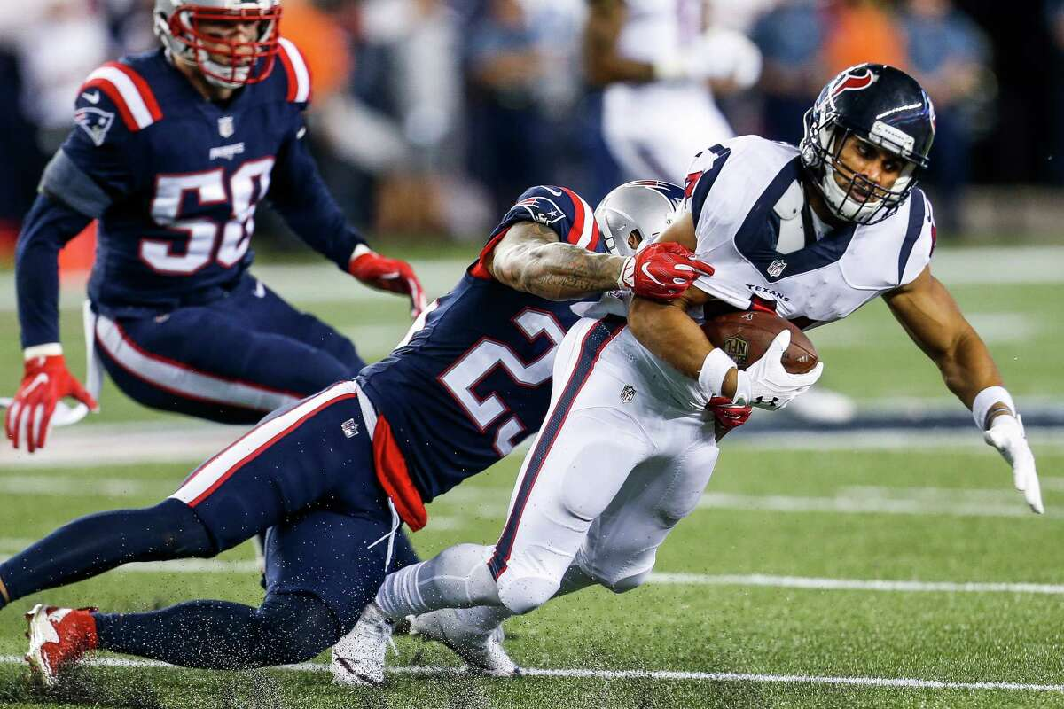New England Patriots strong safety Patrick Chung (23) tackles Houston Texans running back Jonathan Grimes (41) during the fourth quarter of an NFL football game at Gillette Stadium on Thursday, Sept. 22, 2016, in Foxborough, Mass.