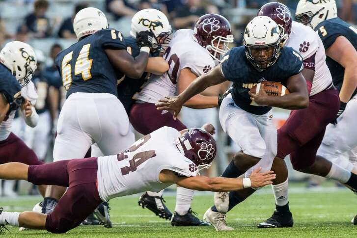 Cy-Ranch runningback Evan Thompson (5) breaks through the line of scrimmage in a high school football game at Cy-Fair FCU Stadium on Thursday, September 22, 2016, in Houston. ( Joe Buvid / For the Chronicle )